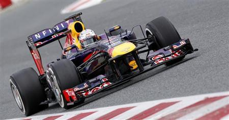 Red Bull Formula One driver Sebastian Vettel of Germany drives during a training session at Circuit de Catalunya racetrack in Montmelo, near Barcelona March 1, 2013. REUTERS/Albert Gea