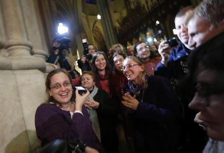 People react to the announcement of newly elected Pope Francis I, Cardinal Jorge Mario Bergoglio of Argentina at St. Patrick's Catherdral in New York, March 13, 2013. REUTERS/Brendan McDermid