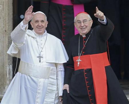 Newly elected Pope Francis, Cardinal Jorge Mario Bergoglio of Argentina (L) waves from the steps of the Santa Maria Maggiore Basilica in Rome, March 14, 2013. At right is Cardinal Agostino Vallini, Vicar General of Rome at right. REUTERS/Alessandro Bianchi