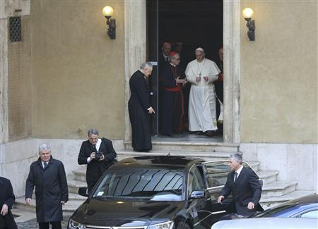 Newly elected Pope Francis, Cardinal Jorge Mario Bergoglio of Argentina leaves after praying at the Santa Maria Maggiore Basilica in Rome, March 14, 2013. REUTERS/Alessandro Bianchi