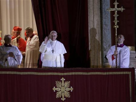 Newly elected Pope Francis, Cardinal Jorge Mario Bergoglio of Argentina appears on the balcony of St. Peter's Basilica after being elected by the conclave of cardinals, at the Vatican, March 13, 2013. White smoke rose from the Sistine Chapel chimney and the bells of St. Peter's Basilica rang out on Wednesday, signaling that Roman Catholic cardinals had elected a pope to succeed Benedict XVI. REUTERS/Max Rossi