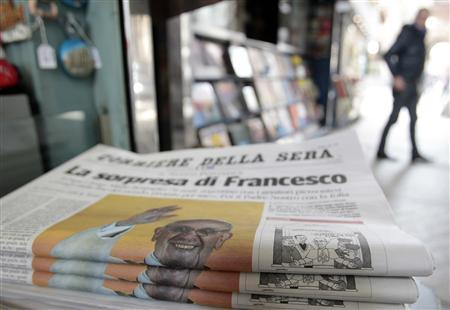 Italian newspapers showing the newly-elected Pope Francis on its front page are seen at a newspaper kiosk in downtown Milan March 14, 2013. REUTERS/Alessandro Garofalo