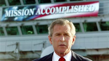U.S. President George W. Bush declares an end to major combat in Iraq during a speech to crew aboard the aircraft carrier USS Abraham Lincoln as the carrier steamed toward San Diego, California, in this May 1, 2003 file photo. REUTERS/Larry Downing/Files