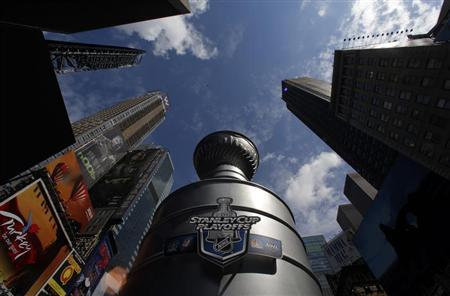 A giant water fountain in the shape of the Stanley Cup, presented to the champions of the National Hockey League (NHL), stands on display in Times Square, New York April 11, 2012. REUTERS/Phil Noble
