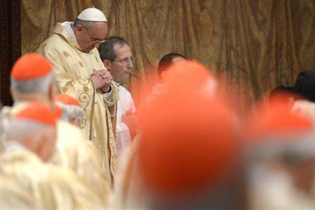 Newly elected Pope Francis I, Cardinal Jorge Mario Bergoglio of Argentina, leads a a mass with cardinals at the Sistine Chapel, in a picture released by Osservatore Romano at the Vatican March 14, 2013. REUTERS/Osservatore Romano