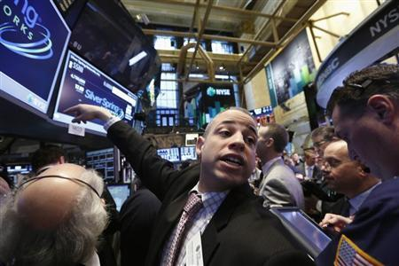 A trader gestures while waiting for Silver Spring Networks to begin trading on the floor at the New York Stock Exchange, March 13, 2013. REUTERS/Brendan McDermid