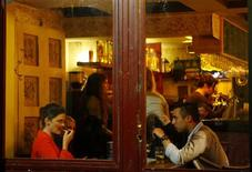 People talk in a bar on Kazinczy street in Budapest, February 24, 2013. REUTERS/Bernadett Szabo