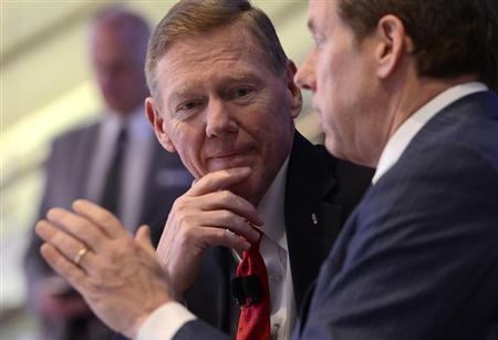 William Clay Ford, Jr. Executive Chairman of Ford Motor Company, and Alan Mulally (L), President and CEO of Ford, chat as they attend the Lincoln press conference at the North American International Auto Show in Detroit, Michigan January 14, 2013. REUTERS/James Fassinger/Files