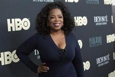 """Television personality Oprah Winfrey attends HBO's New York premiere of the documentary """"Beyonce - Life is But a Dream"""" in New York February 12, 2013. REUTERS/Andrew Kelly"""