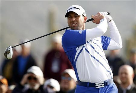 Sergio Garcia of Spain watches his tee shot on the first hole during the second round of the WGC-Accenture Match Play Championship golf tournament in Marana, Arizona February 22, 2013. REUTERS/Matt Sullivan