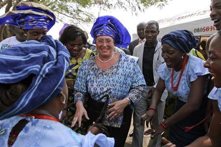 Under-Secretary-General and Executive Director of United Nations (UN) Women Michelle Bachelet (C) of Chile dances with women upon her arrival at Ushafa pottery village during an official visit to Nigeria's capital Abuja January 11, 2013. Picture taken January 11, 2013. REUTERS/Afolabi Sotunde