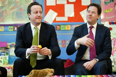 Prime Minister David Cameron (L) and Deputy Prime Minister Nick Clegg sit during a visit to a day nursery in London March 19, 2013. REUTERS/Jeremy Selwyn/Pool