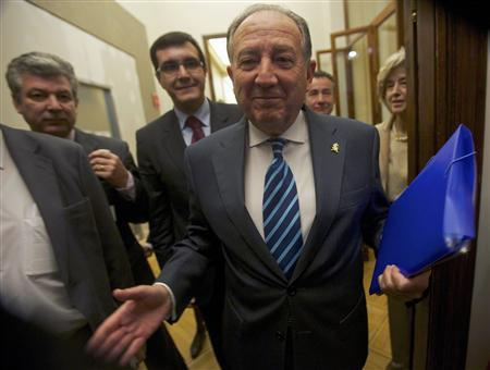 Spain's intelligence chief General Felix Sanz Roldan gestures as he arrives at Parliament to appear before a commission in Madrid March 19, 2013. REUTERS/Sergio Perez
