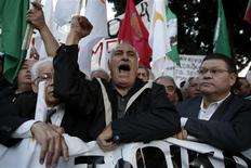 Protesters shout slogans during an anti-bailout rally outside the parliament in Nicosia March 19, 2013. REUTERS/Yorgos Karahalis