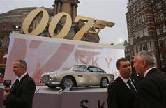 "An Aston Martin car is displayed near television crews before guests arrive for the royal world premiere of the new 007 film ""Skyfall"" at the Royal Albert Hall in London October 23, 2012. REUTERS/Chris Helgren"
