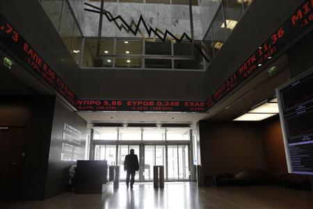A man walks inside the the reception hall of the Athens stock exchange March 19, 2013. REUTERS/John Kolesidis
