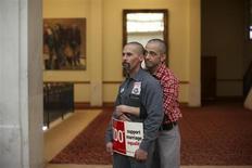 Same-sex couple Frank Capley (L) and Joe Alfano listen to a speaker at City Hall in San Francisco, California February 14, 2013. REUTERS/Robert Galbraith