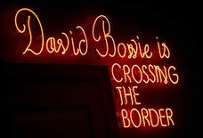 """A neon sign is seen at the """"David Bowie is"""" Exhibition at the Victoria and Albert Museum in London, March 20, 2013. REUTERS/Neil Hall"""