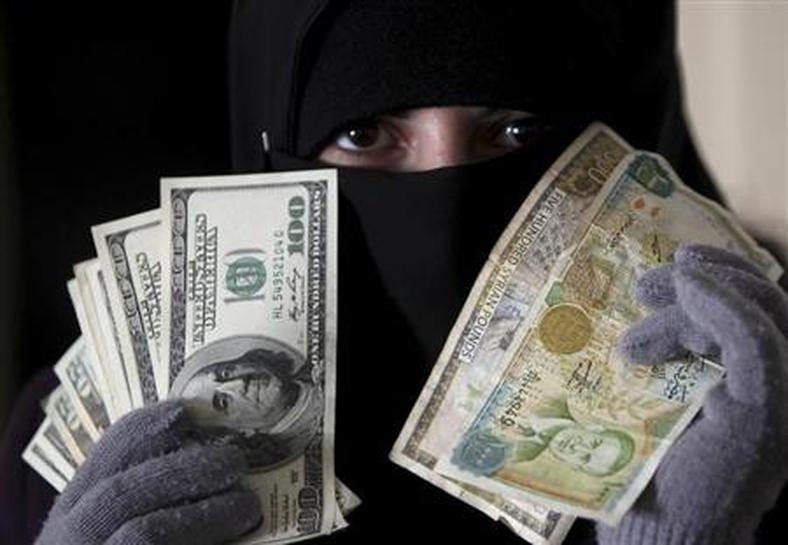 Syria Pound Touches Record Low Against