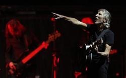 """Pink Floyd co-founder and musician Roger Waters performs during the last show of his """"The Wall"""" tour on the Plains of Abraham in Quebec City, July 21, 2012. REUTERS/Mathieu Belanger"""
