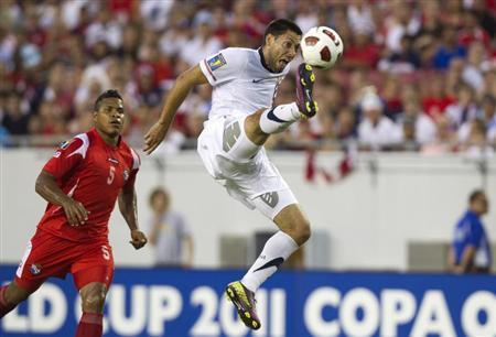 United States' Clint Dempsey takes a shot on goal near Panama's Roman Torres (L) during the first half of their CONCACAF Gold Cup soccer match in Tampa, Florida June 11, 2011. REUTERS/Scott Audette