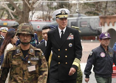 U.S. Admiral Samuel Locklear (C), Commander of the U.S. Pacific Command, is accompanied by Shigeru Iwasaki (R), Chief of Japan's Self-Defence Forces Joint Staff, as he arrives to inspect the Patriot Advanced Capability-3 (PAC-3) land-to-air missile deployed at the Defence Ministry in Tokyo April 11, 2012. REUTERS/Yuriko Nakao