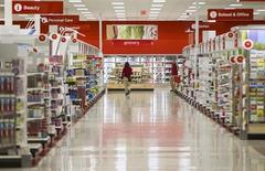 An employee walks down rows of shelves at the new Target store in Guelph, Ontario, March 4, 2013, on the eve of the store's opening. REUTERS/Geoff Robins