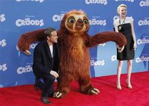 """Cast members Ryan Reynolds (L) and Emma Stone arrive for the premiere of the film """"The Croods"""" in New York, March 10, 2013. REUTERS/Carlo Allegri"""