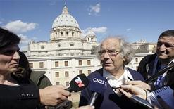 """Adolfo Perez Esquivel speaks with media after a private meeting at the Vatican with Pope Francis, in Rome, March 21, 2013. Esquivel defended Pope Francis on Thursday against accusations he failed to speak out against repression during the 1976-83 military dictatorship in their native Argentina, saying he prefered """"silent diplomacy"""". REUTERS/Remo Casilli"""