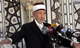 A file photo shows high-level cleric Mohammed al-Buti speaking at a mosque, in this handout photograph distributed by Syria's national news agency SANA on March 21, 2013. REUTERS/SANA/Handout