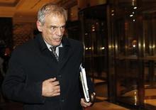 Le ministre des Finances chypriote, Michael Sarris. Chypre est tout près de parvenir à un accord sur le moyen de lever les quelque six milliards d'euros réclamés par l'Union européenne pour mettre en oeuvre le plan de sauvetage de l'île et éviter un effondrement financier, prélude à une sortie de la zone euro, a assuré vendredi le parti au pouvoir à Nicosie./Photo prise le 21 mars 2013/REUTERS/Maxim Shemetov