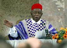 File photo of Nigerian author Chinua Achebe making a speech of thanks during an award ceremony in Frankfurt's St.Paul's Church October 13, 2002.