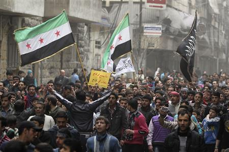 Demonstrators chant slogans, dance and wave Syrian opposition flags during a protest against President Bashar al-Assad in Bustan al-Qasr district in Aleppo March 22, 2013. REUTERS-Giath Taha