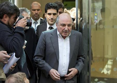 Russian oligarch Boris Berezovsky leaves after losing his court battle against Roman Abramovich, at a division of the High Court in London August 31, 2012. REUTERS/Neil Hall