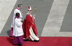 Pope Francis (R) attends the Palm Sunday mass at Saint Peter's Square at the Vatican March 24, 2013. REUTERS/Max Rossi