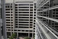 The International Monetary Fund (IMF) headquarters building is seen through a World Bank window in Washington April 21, 2012. REUTERS/Yuri Gripas