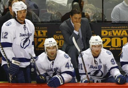 Tampa Bay Lightning head coach Guy Boucher reacts at the end of the second period of NHL hockey action in Montreal, April 4, 2012. REUTERS/Olivier Jean
