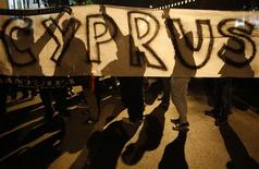 """Anti-Troika protesters hold a """"Hands off Cyprus"""" banner during a demonstration outside the EU offices in Nicosia March 24, 2013. REUTERS/Yannis Behrakis"""
