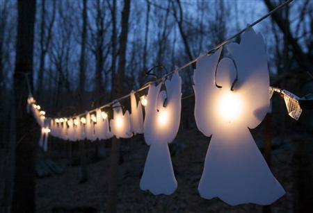 Lighted angels hang from a tree in Monroe, Connecticut January 14, 2013, on the one-month anniversary of the shooting at Sandy Hook elementary School in Newtown that killed 20 children and six staff members. REUTERS/Michelle McLoughlin
