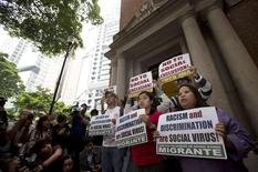 Eman Villanueva (3rd R, front row), spokesperson for the Asian Migrants' Coordinating Body (AMCB), and other domestic helper groups hold banners during a protest outside the Court of Final Appeal in Hong Kong March 25, 2013. REUTERS/Tyrone Siu