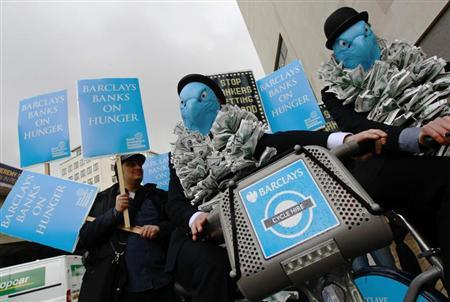 Demonstrators stage a protest outside the Barclays AGM at the Royal Festival Hall in London April 27, 2012. REUTERS/Luke MacGregor