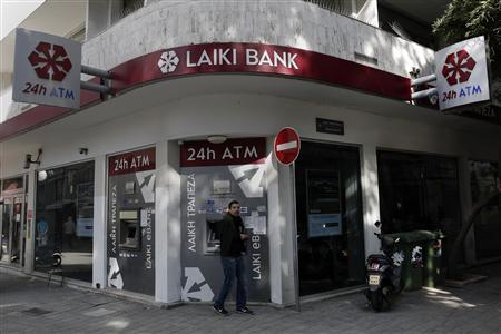 A man leaves a Laiki Bank ATM in Nicosia March 25, 2013. REUTERS/Yorgos Karahalis