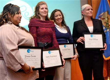 Yvonne Estrada, Lacey Copenhaver, DaChelle Black and Diane Billings (L-R) are the first graduates from ReMerge, Oklahoma County's prison alternative program, in Oklahoma, City, Oklahoma, March 25, 2013. REUTERS/Steve Olafson