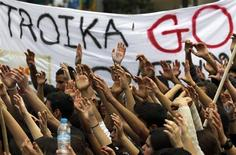 Students take part in an anti-Troika protest outside the Presidencial palace in Nicosia March 26, 2013. REUTERS/Yannis Behrakis