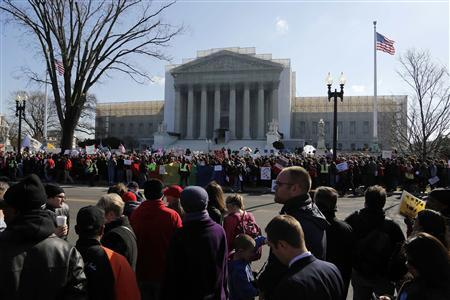 Anti-Proposition 8 protesters line both sides of the street in front of the U.S. Supreme Court in Washington March 26, 2013. REUTERS/Jonathan Ernst