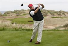 U.S. property magnate Donald Trump practices his swing at the 13th tee of his new Trump International Golf Links course on the Menie Estate near Aberdeen, north east Scotland June 20, 2011. REUTERS/David Moir