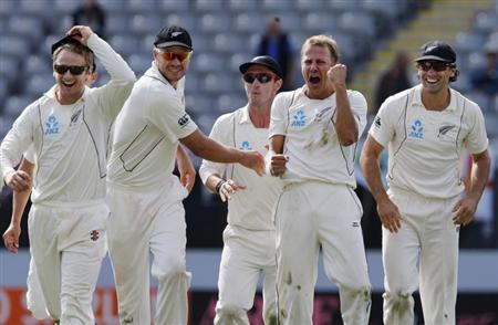New Zealand's Neil Wagner (2nd R) celebrates dismissing England's Ian Bell with (L to R) Kane Williamson, Peter Fulton, Hamish Rutherford and Dean Brownlie on day five of their final cricket test at Eden Park in Auckland, March 26, 2013. REUTERS/Nigel Marple
