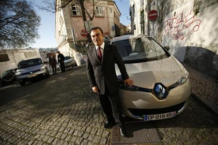 Carlos Ghosn, chairman and chief executive cfficer of French carmaker Renault, poses next to a Renault Zoe new electric car after a meeting with journalists in downtown Lisbon March 14, 2013. REUTERS/Rafael Marchante
