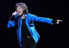 """Mick Jagger performs onstage during the Rolling Stones final concert of their """"50 and Counting Tour"""" in Newark, New Jersey, December 15, 2012 REUTERS/Carlo Allegri"""