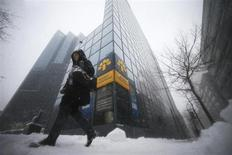 A pedestrian walks past the head offices of Laurentian Bank in Montreal, March 19, 2013. REUTERS/Christinne Muschi